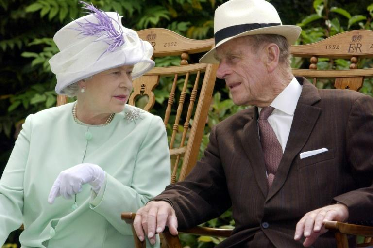 """Britain's Queen Elizabeth II and Prince Philip, who is undergoing hospital treatment for what Buckingham Palace described as a """"pre-existing condition"""""""