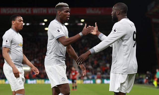 Romelu Lukaku celebrates scoring Manchester United's second goal against Bournemouth with Paul Pogba and Anthony Martial.