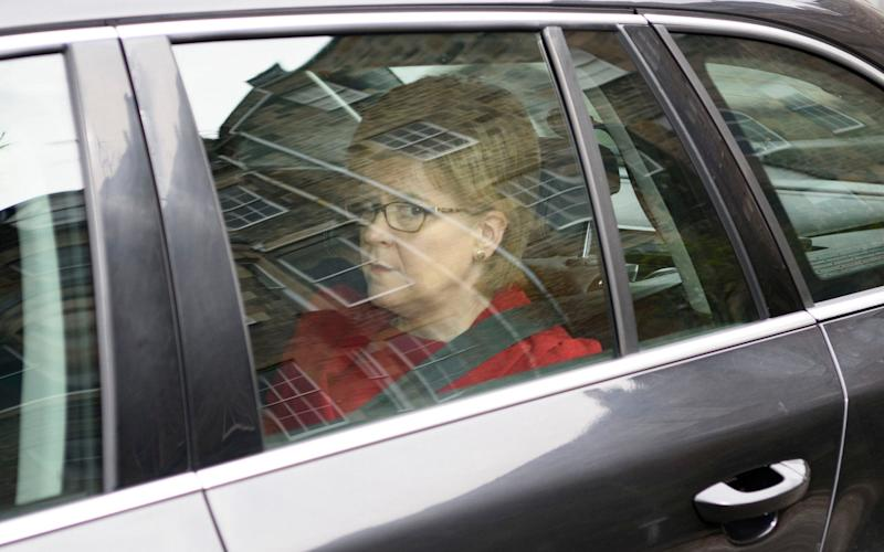 "First Minister Nicola Sturgeon leaves Bute House in Edinburgh, as she has warned that the Prime Minister's plans for a shock general election could be a ""huge political miscalculation"" - Credit: PA"