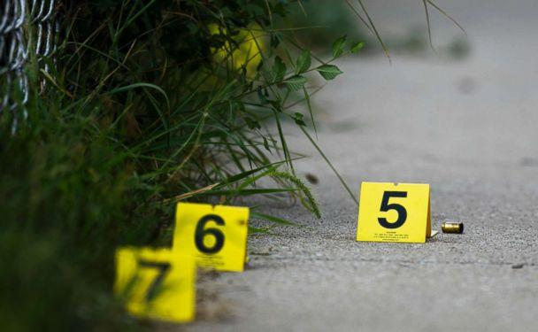 PHOTO: Evidence markers sit on the ground at the scene where a boy was killed after being shot in the abdomen while riding his bike in Chicago, Ill, Aug.5, 2018. (Armando L. Sanchez/Chicago Tribune via AP)