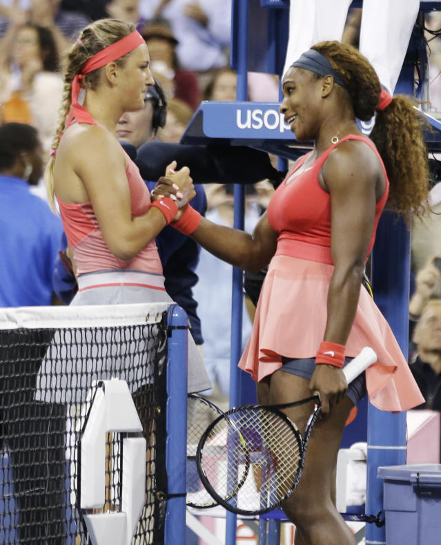 Serena Williams, right, greets Victoria Azarenka, of Belarus, at the net after winning the women's singles final of the 2013 U.S. Open tennis tournament, Sunday, Sept. 8, 2013, in New York. (AP Photo/David Goldman)