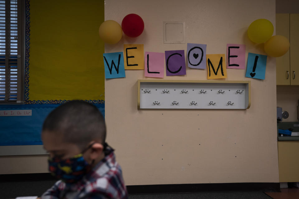 A welcome sign adorns a kindergarten classroom on the first day of in-person learning at Maurice Sendak Elementary School in Los Angeles, Tuesday, April 13, 2021. More than a year after the pandemic forced all of California's schools to close classroom doors, some of the state's largest school districts are slowly beginning to reopen this week for in-person instruction. (AP Photo/Jae C. Hong)