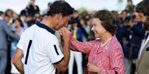 <p>After Prince Charles won a polo match, his mother presented him with a prize and he kissed her hand as a thank you.</p>
