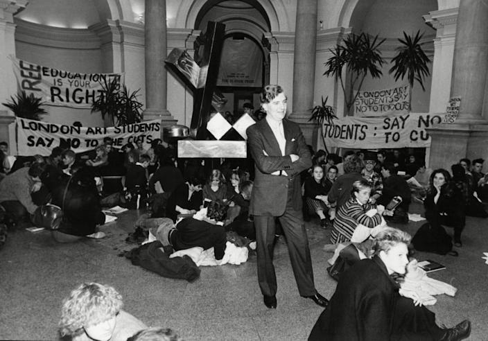 Bowness, director of the Tate Gallery, mingling with art students protesting against cuts to educational grants in 1984 - Shutterstock