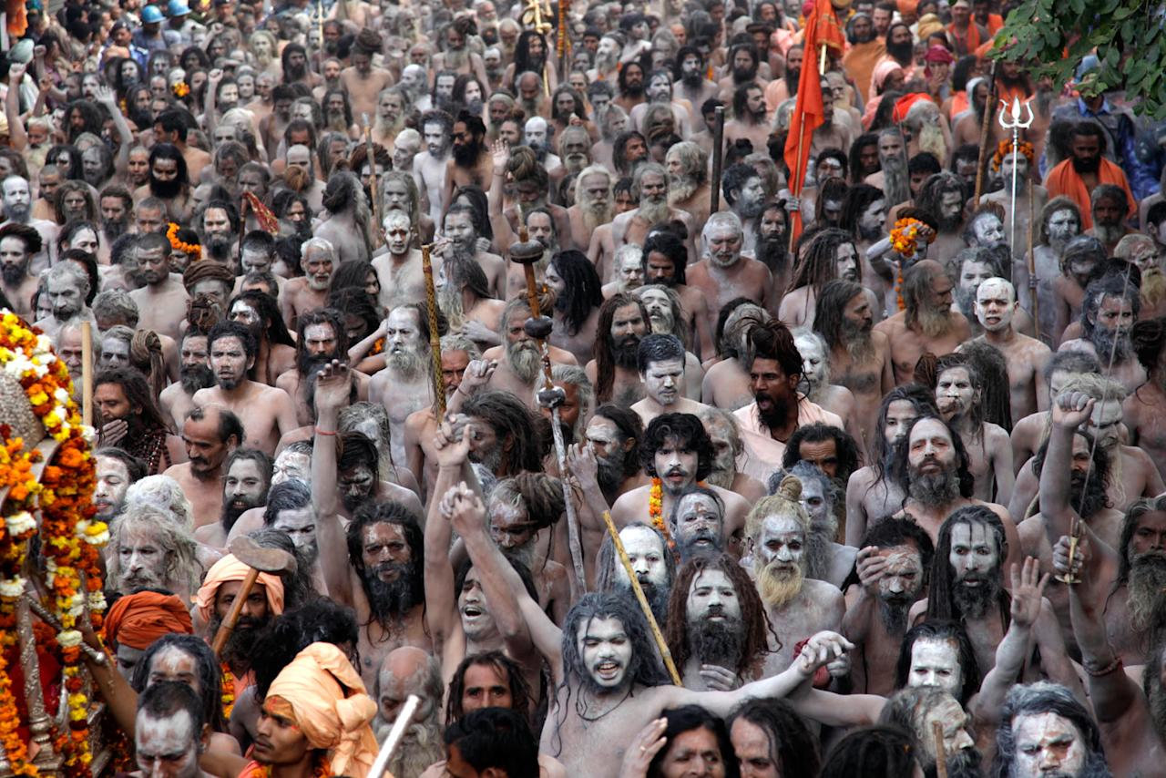 Sadhu (holy men) march on the street during Kumbh Mela, the largest Hindu gathering in the world, February 12, 2010 in Haridwar, India. Hindus believe that bathing in the Ganges during the festival cleanses them of sin.
