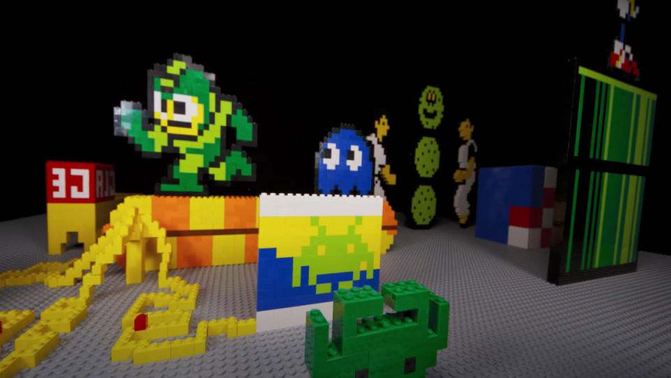 """A frame from an 8-Bit-Style LEGO Stop-Motion video featuring """"8-bit"""" versions of characters from classic video games."""