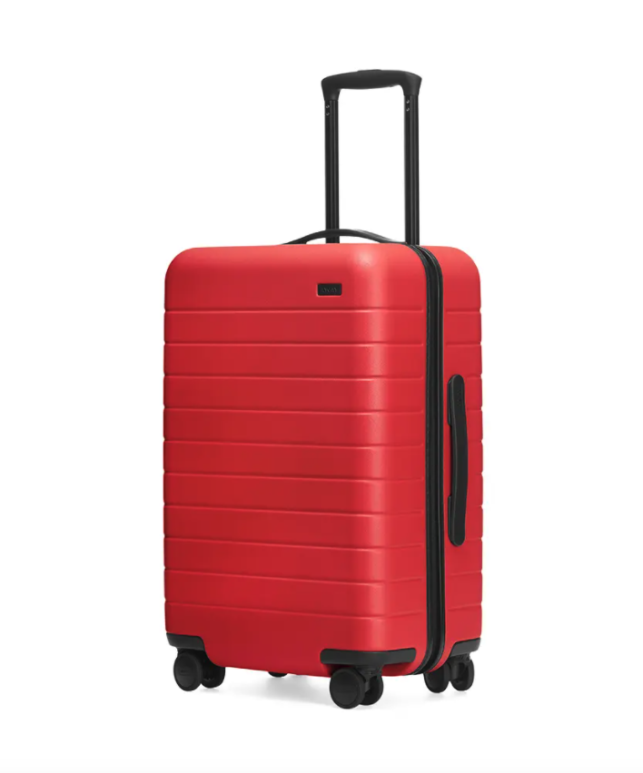 """<h2>The Away Bigger Carry-On</h2><br>With endless pockets and plenty of space, this carry-on is an organizer's dream.<br><br><strong>Away</strong> The Bigger Carry-On, $, available at <a href=""""https://go.skimresources.com/?id=30283X879131&url=https%3A%2F%2Fwww.awaytravel.com%2Fsuitcases%2Fbigger-carry-on-without-battery%2Fcherry"""" rel=""""nofollow noopener"""" target=""""_blank"""" data-ylk=""""slk:Away"""" class=""""link rapid-noclick-resp"""">Away</a>"""