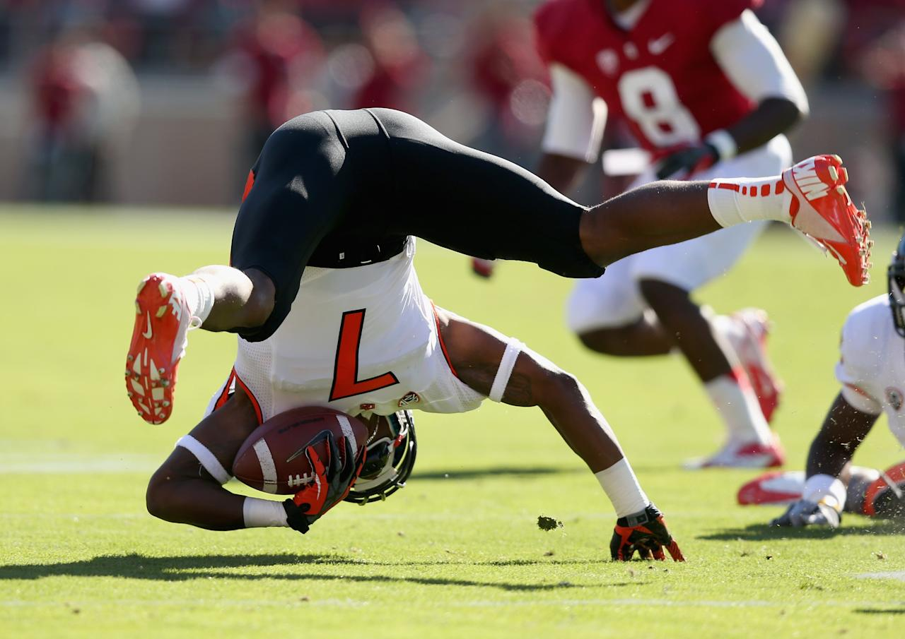 STANFORD, CA - NOVEMBER 10: Brandin Cooks #7 of the Oregon State Beavers loses his balance after he is hit by a Stanford Cardinal player at Stanford Stadium on November 10, 2012 in Stanford, California.  (Photo by Ezra Shaw/Getty Images)