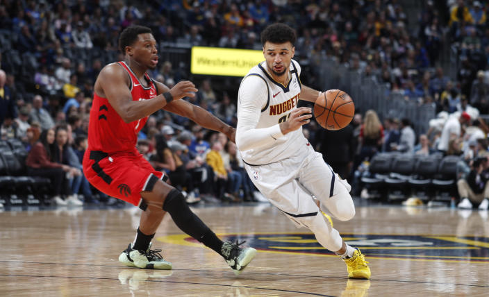 FILE - Denver Nuggets guard Jamal Murray, right, rives past Toronto Raptors guard Kyle Lowry in the second half of an NBA basketball game in Denver, in this Sunday, March 1, 2020, file photo. The Nuggets will open the NBA basketball exhibition season with two home contests against the Portland Trailblazers this week. (AP Photo/David Zalubowski, File)