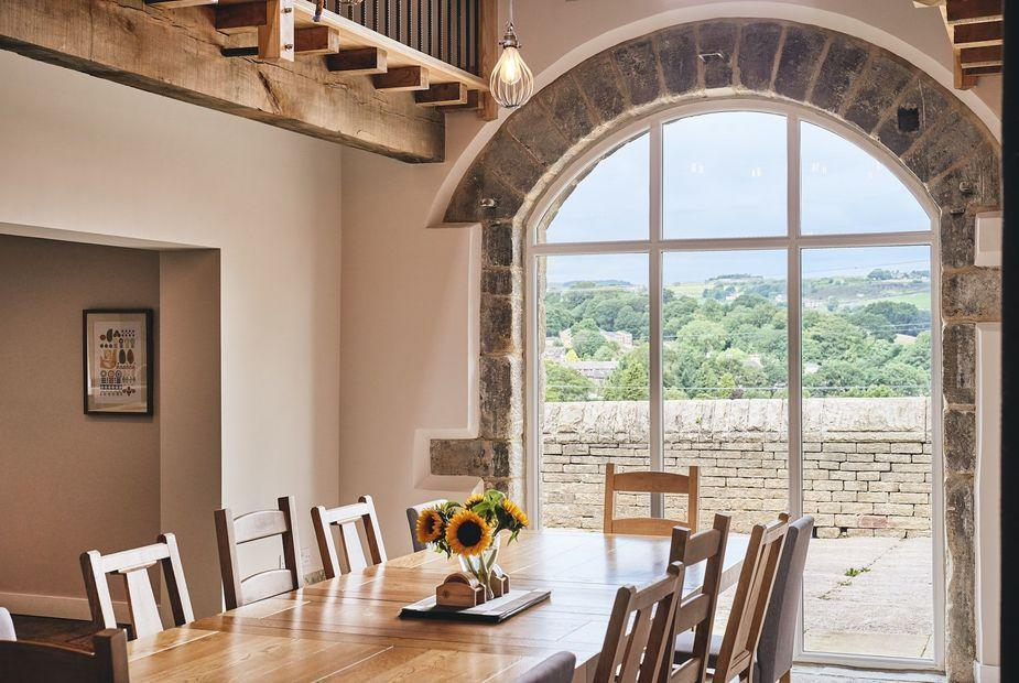 "<p>A stylish barn conversion with gloriously rural views, The Cowshed is set in an idyllic village near Ripponden in West Yorkshire. It's spacious and thoughtfully renovated, as well as an excellent base for exploring the local countryside with plenty of walks on your doorstep and pretty villages to visit. </p><p>The holiday let is chic while retaining its period features and you'll love the high spec open plan kitchen and dining area that's light, airy and features a large arched window at one end with breathtaking views. </p><p><a class=""link rapid-noclick-resp"" href=""https://go.redirectingat.com?id=127X1599956&url=https%3A%2F%2Fwww.snaptrip.com%2Fproperties%2Funited-kingdom%2Fengland%2Fyorkshire-and-the-humber%2Fleeds%2Fthe-cowshed-west-yorkshire%3Fcheck_in_on%3D18-06-2021%26nights%3D2&sref=https%3A%2F%2Fwww.redonline.co.uk%2Ftravel%2Finspiration%2Fg35898470%2Foutdoor-drinking-dining-staycation-ideas%2F"" rel=""nofollow noopener"" target=""_blank"" data-ylk=""slk:CHECK AVAILABILITY"">CHECK AVAILABILITY</a></p>"
