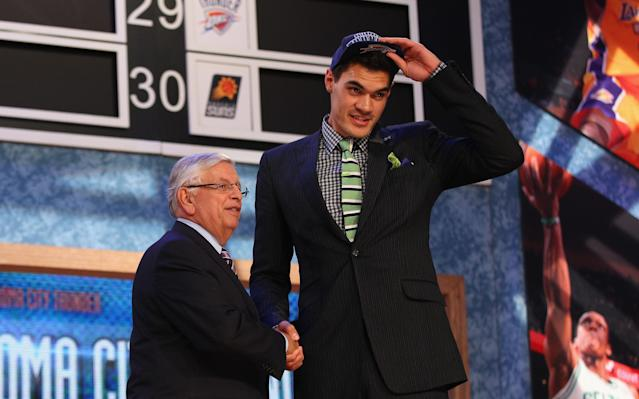"<a class=""link rapid-noclick-resp"" href=""/nba/players/5163/"" data-ylk=""slk:Steven Adams"">Steven Adams</a> takes a break from shaking David Stern's hand to see if that dude with the whoops-suit is still milling around. (Getty)"