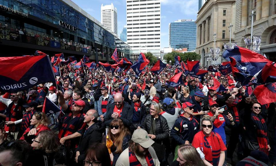 Demons fans are seen during a grand final winners celebration event in Perth on Sunday.