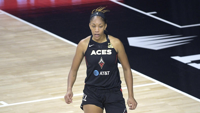 A'ja Wilson in a black Aces uniform on the court.