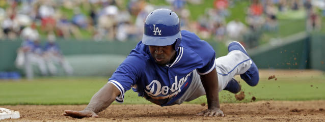 Los Angeles Dodgers' Chone Figgins slides safely back to first on a pick off attempt during the third inning of an exhibition spring training baseball game against the Los Angeles Angels Thursday, March 6, 2014, in Tempe, Ariz. (AP Photo/Morry Gash)