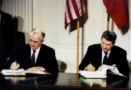 FILE PHOTO: Ronald Reagan and Mikhail Gorbachev sign the Intermediate-Range Nuclear Forces (INF) treaty in 1987