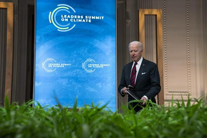 President Joe Biden takes his seat during the virtual Leaders Summit on Climate, from the East Room of the White House, Thursday, April 22, 2021, in Washington. (AP Photo/Evan Vucci)