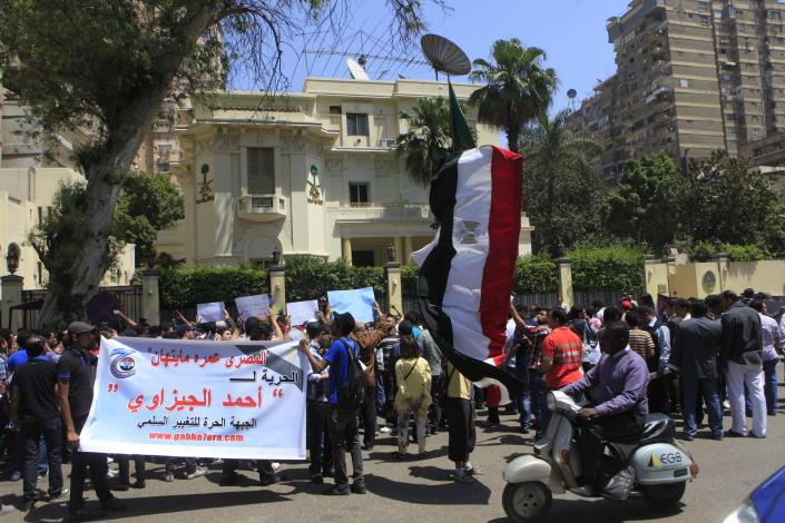 "FILE - In this Tuesday, April 24, 2012 file photo, Egyptian protesters demonstrate in front of the Saudi Embassy in Cairo, Egypt to demand the release of an Egyptian human rights lawyer detained in Saudi Arabia for allegedly insulting the kingdom's monarch. Arabic on the banner read, ""Egyptians will never be insulted, freedom for Ahmed el-Gezawi."" Saudi Arabia said Saturday, April 28, 2012 that it has closed embassy in Cairo because of protests over a detained Egyptian. (AP Photo)"