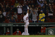 Boston Red Sox's Bobby Dalbec acknowledges the fans after his two-run home run against the Los Angeles Angels during the seventh inning of a baseball game Friday, May 14, 2021, at Fenway Park in Boston. (AP Photo/Winslow Townson)