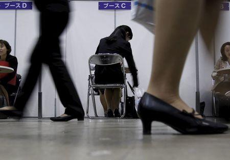 A female job seeker takes part in a job hunting counseling session with advisers during a job fair held for fresh graduates in Tokyo, Japan, March 20, 2016. REUTERS/Yuya Shino