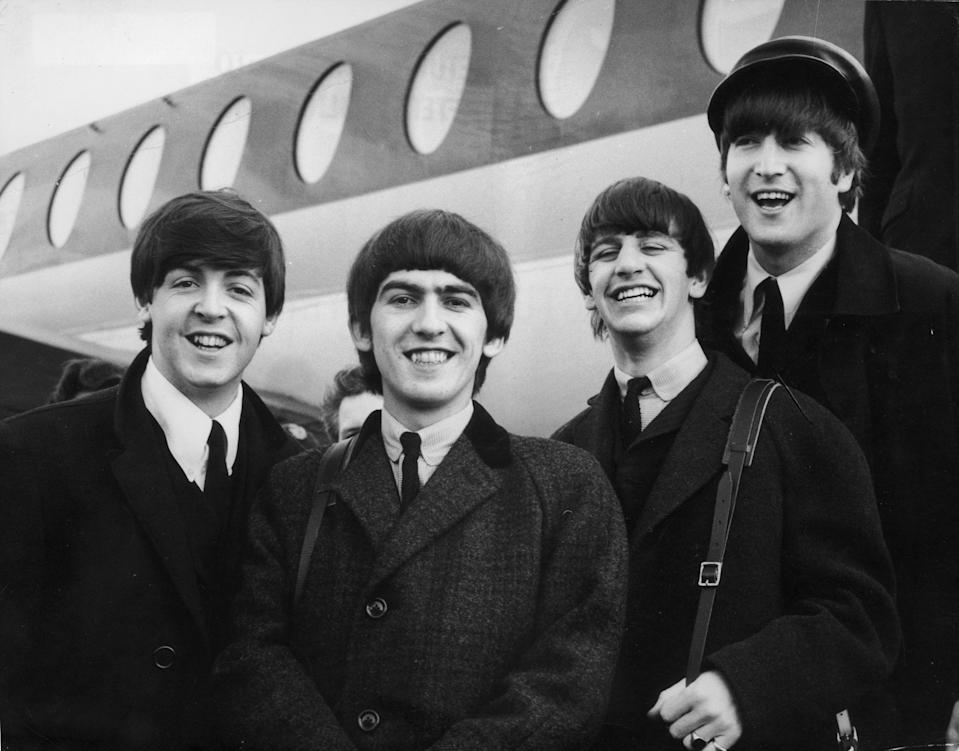 <p>The Beatles arriving at London Airport after a trip to Paris in 1964</p> (Getty)