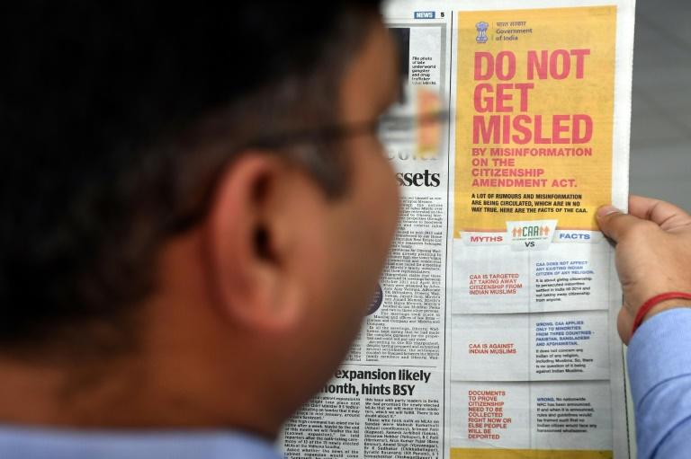 """The ruling right-wing government also carried an advertisement across all national dailies, with a """"myths vs facts"""" explainer to show the law was not against India's 200 million Muslims (AFP Photo/Prakash SINGH)"""