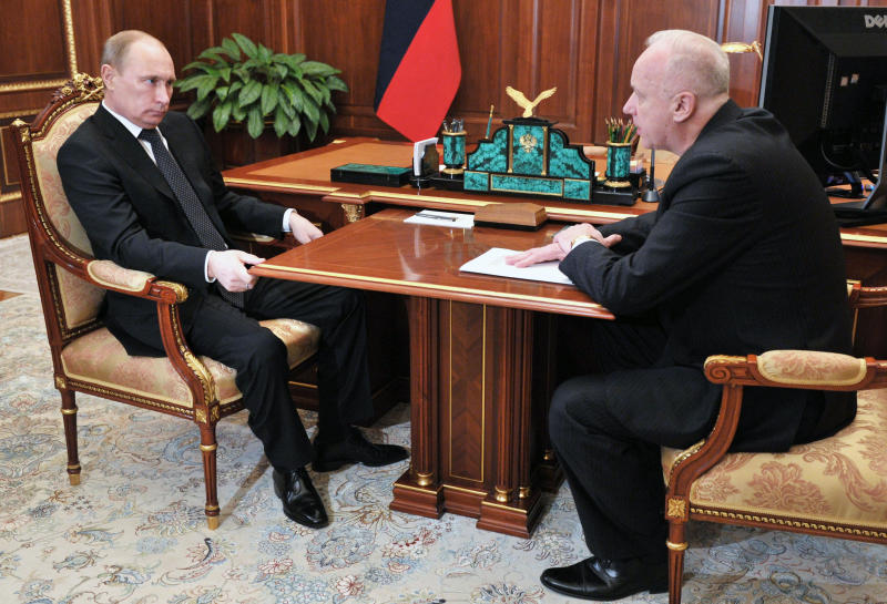 FILE In this file photo taken on Thursday, Dec. 13, 2012, Russian President Vladimir Putin, left, meets with Investigative Committee Chief Alexander Bastrykin in the Kremlin in Moscow, Russia. Bastrykin struggled to respond to documents released by Russian opposition leader Alexei Navalny that showed that he allegedly had unregistered real estate in the Czech Republic, as well as a legal firm which allegedly had failed to pay taxes. Bastrykin's agency spearheaded the ongoing crackdown on the opposition.(AP Photo/RIA-Novosti, Alexei Nikolsky, Presidential Press Service)