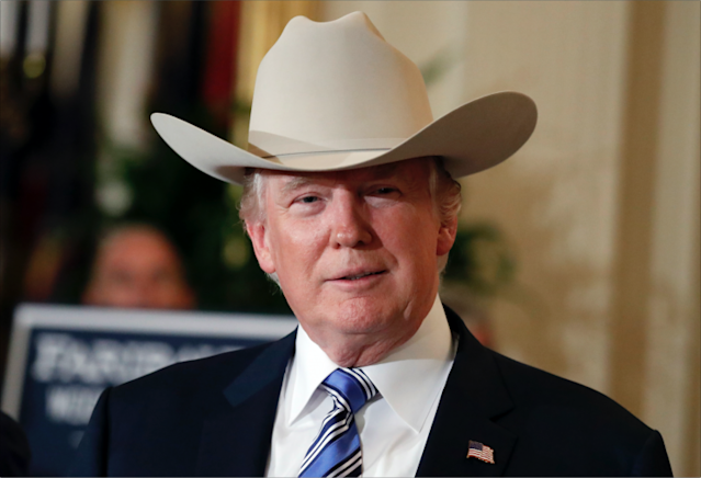 President Trump goes full cowboy. (Photo: AP Images)