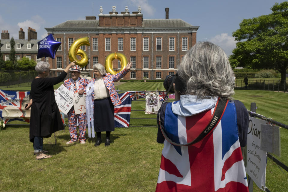 On the day after what would have been the 60th birthday of Princess Diana, people gather to pay their respects, and to lay flowers, pictures and messages at a memorial to her at the gates of Kensington Palace on 2nd July 2021 in London, United Kingdom. Diana, Princess of Wales became known as the Peoples Princess following her tragic death, and now as in 1997, many royalists, and mourners came to her royal residence in remembrance and respect. (photo by Mike Kemp/In Pictures via Getty Images)
