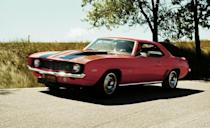 <p>The 1969 Z/28 wasn't mechanically much different from the '67 and '68 models, but many consider it the ultimate Camaro in appearance. During the 1969 model year, the Z/28 was joined by two special-order, low-volume, and race-oriented models. Built through the Central Office Production Order (COPO) system, they were the COPO 9560 and 9561. The 9561 was powered by the 425-hp, L72 iron-block 427-cubic-inch (7.0-liter) big-block V-8, and many of the examples made went to Yenko Chevrolet in Pennsylvania, where they became the Yenko Camaro. Only 69 of the 9560s were built, and they were all powered by the aluminum ZL-1 big-block also rated at 425 horsepower. Those ZL-1 Camaros built in 1969 are considered the most collectible of them all.</p>
