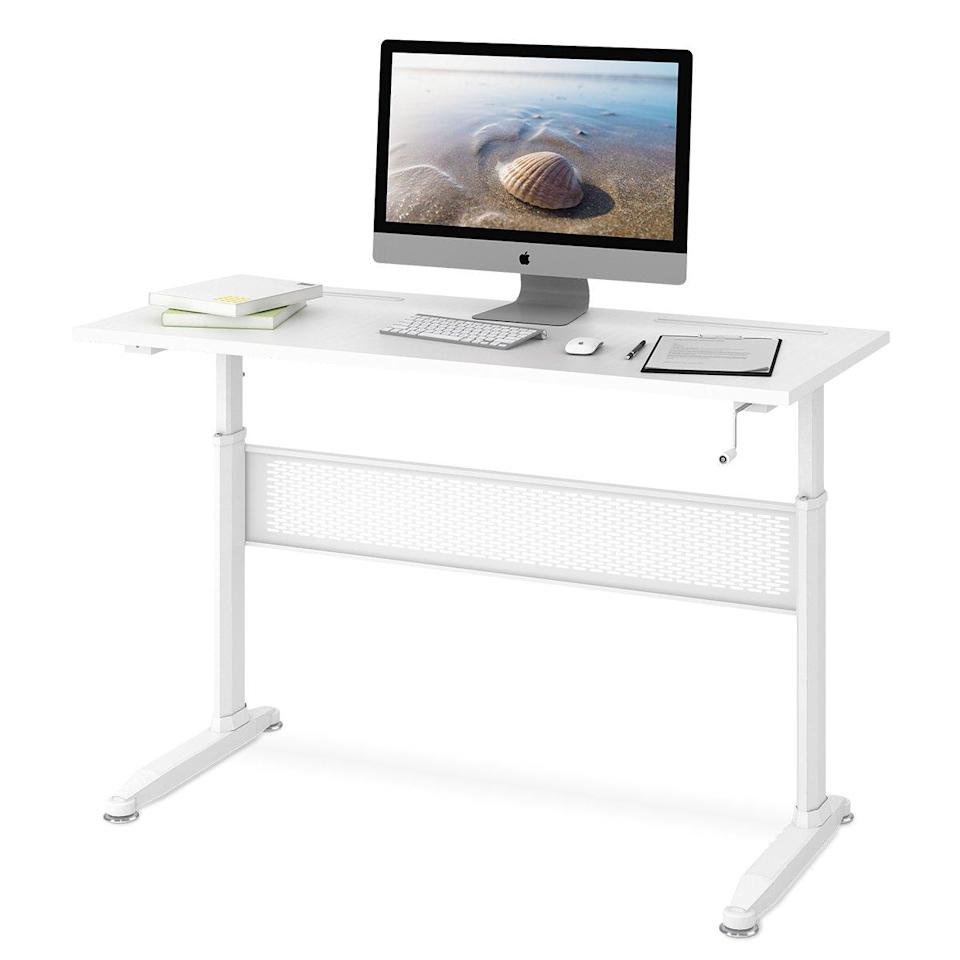 """<h3><strong>Standing Desk Under $250</strong></h3><br><br>This adjustable standing desk can go from 29 inches to 45 inches with the crank handle, allowing you to choose whatever height is most comfortable for you. And, with enough space for two monitors, this desk is a perfect addition to any office.<br><br><strong><a href=""""https://www.amazon.com/DEVAISE-Adjustable-Height-Standing-Handle/product-reviews/B01N4CE155/ref=cm_cr_dp_d_show_all_btm?ie=UTF8&reviewerType=all_reviews"""" rel=""""nofollow noopener"""" target=""""_blank"""" data-ylk=""""slk:What people are saying"""" class=""""link rapid-noclick-resp"""">What people are saying</a></strong>: """"When my body complains about my hours at the computer, it really helps to have a desk that I can adjust as often as I want throughout the day. I sit, I stand, I adjust my monitor with an adjustable monitor rack and I have a few things to rest my feet on under my desk. This desk is sturdy, the surface size is ample for files and notebooks, etc, and it's easy enough for me to crank the handle for 30 seconds to change the height sometimes as often as four times a day.""""<br><br><strong>Devaise</strong> DEVAISE Adjustable Height Standing Desk , $, available at <a href=""""https://www.amazon.com/DEVAISE-Adjustable-Height-Standing-Handle/dp/B01N4CE155/ref=as_li_ss_tl?creativeASIN=B01N4CE155&imprToken=75f1bpSDVIg3VeJFNxuv6Q&slotNum=4&keywords=devaise+crank+desk&qid=1551815347&s=gateway&sr=8-5-fkmrnull&th=1&linkCode=w61&tag=standingdesks-03052019-20&linkId=7930981959aecf056ebdfeb170073be9&language=en_US"""" rel=""""nofollow noopener"""" target=""""_blank"""" data-ylk=""""slk:Amazon"""" class=""""link rapid-noclick-resp"""">Amazon</a>"""