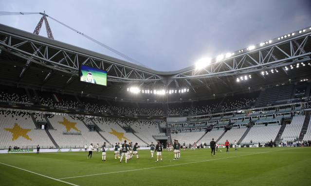 Juventus players warm-up before an Italian Cup second leg soccer match between Juventus and AC Milan at the Allianz stadium, in Turin, Italy, Friday, June 12, 2020. The match was being played without spectators because of the coronavirus lockdown. (AP Photo/Luca Bruno)