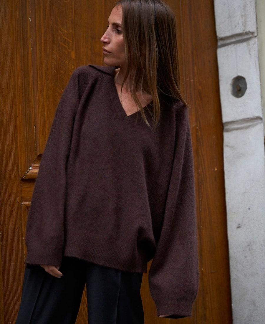 """Emphasize the collar and deep neckline of this roomy sweater with layers of gold chains. $216, Nordstrom. <a href=""""https://www.nordstrom.com/s/loulou-studio-oversized-wool-blend-polo-sweater/5672135?"""" rel=""""nofollow noopener"""" target=""""_blank"""" data-ylk=""""slk:Get it now!"""" class=""""link rapid-noclick-resp"""">Get it now!</a>"""