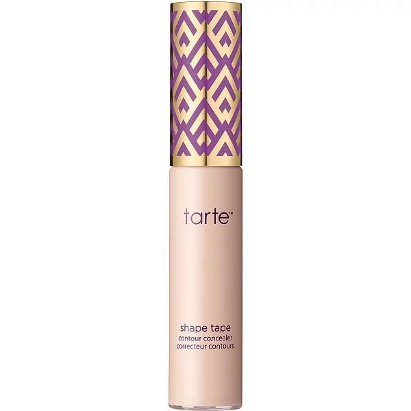 """<p>With all eyes on you, a little concealer can go a long way. """"Apply <a href=""""https://www.popsugar.com/buy/Tarte-Cosmetics-Shape-Tape-Contour-Concealer-550623?p_name=Tarte%20Cosmetics%20Shape%20Tape%20Contour%20Concealer&retailer=ulta.com&pid=550623&price=27&evar1=bella%3Aus&evar9=47332424&evar98=https%3A%2F%2Fwww.popsugar.com%2Fphoto-gallery%2F47332424%2Fimage%2F47332426%2FStep-2-Conceal-Under-Your-Eyes&list1=eye%20makeup%2Cneon%2Cbeauty%20trends&prop13=api&pdata=1"""" rel=""""nofollow"""" data-shoppable-link=""""1"""" target=""""_blank"""" class=""""ga-track"""" data-ga-category=""""Related"""" data-ga-label=""""https://www.ulta.com/shape-tape-concealer?productId=xlsImpprod14251035"""" data-ga-action=""""In-Line Links"""">Tarte Cosmetics Shape Tape Contour Concealer</a> ($27) under your eyes to brighten and to hide the appearance of fine lines and dark circles,"""" Adam said. </p>"""