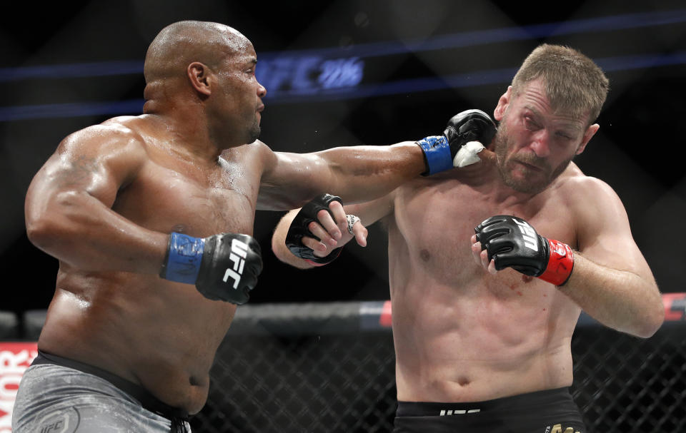 Daniel Cormier punches Stipe Miocic during a heavyweight title bout in 2018. (AP Photo/John Locher)