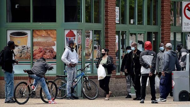 PHOTO: People in the Southeast neighborhoods of Washington stand in the street without respecting social distances, amid the coronavirus pandemic, May 19, 2020. (Olivier Douliery/AFP via Getty Images)