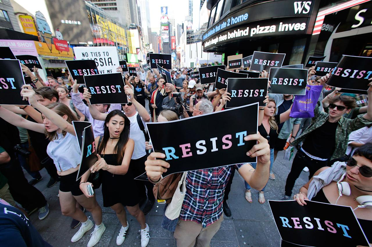 "<p>Protesters gather in Times Square, Wednesday, July 26, 2017, in New York, after President Trump declared a ban on transgender troops serving anywhere in the U.S. military. Trump's announcement caught the Pentagon flat-footed and unable to explain what it called Trump's ""guidance."" His proclamation, on Twitter rather than via any formal announcement, drew bipartisan denunciations and threw currently serving transgender soldiers into limbo. (Photo: Frank Franklin II/AP) </p>"