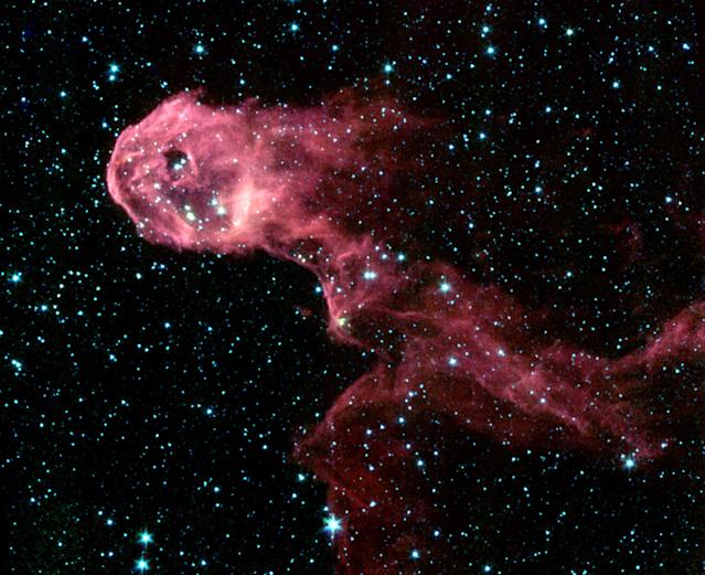 Image shows composite image of Elephant's Trunk Nebula, an elongated dark globule within the emission nebula IC 1396 in the constellation of Cepheus, one of the first images from the new Spitzer Space Telescope released by NASA on December 18, 2003. The new Spitzer Space Telescope, that looks at the cosmos with infrared detectors, has lifted the dust veils from newborn stars and a bumptious comet, and revealed the detail in the spiral arms of a neighboring galazy. Unlike the [Hubble Space Telescope], which takes pictures of the universe from high in Earth orbit, Spitzer makes its observations as it trails behind Earth as our planet circles the sun. Reuters