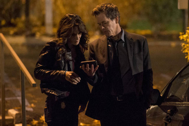 "Ryan Hardy (Kevin Bacon) and FBI Specialist Parker (Annie Parisse) gather information in the ""Welcome Home"" episode of ""The Following."""
