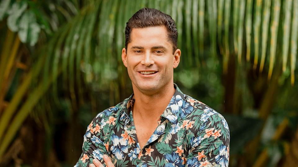 Bachelor in Paradise star Jamie Doran on the show in 2020 wearing a floral shirt