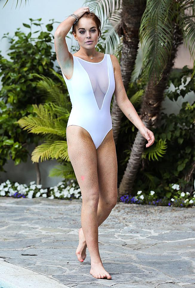 Lindsay Lohan looked the best she has in a long time in a white one-piece with a deep V-cut made of mesh while sunbathing in Hollywood on August 5. And the modest look went along with her low-key behavior that day by the pool: She read Oprah's <em>O</em> magazine. (8/5/2012)