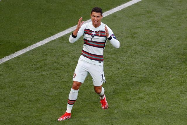Cristiano Ronaldo reacts after missing a chance