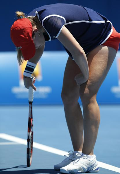 Alize Cornet of France rests on her racket during her second round match against Camila Giorgi of Italy at the Australian Open tennis championship in Melbourne, Australia, Thursday, Jan. 16, 2014.(AP Photo/Eugene Hoshiko)