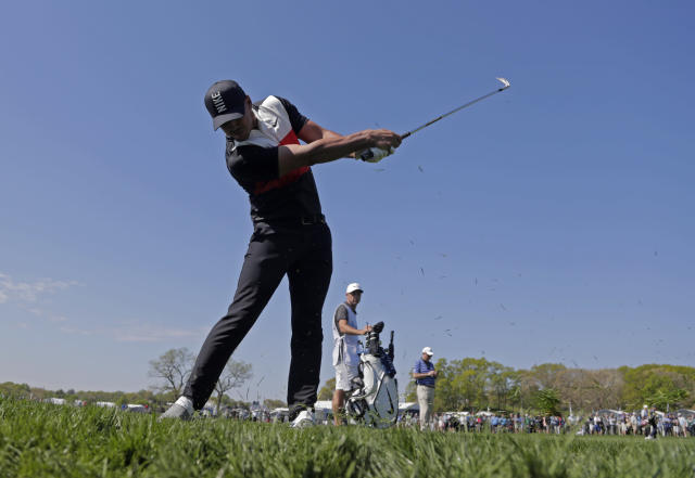 Brooks Koepka hits out of the rough on the 15th hole during the first round of the PGA Championship golf tournament, Thursday, May 16, 2019, at Bethpage Black in Farmingdale, N.Y. (AP Photo/Julio Cortez)
