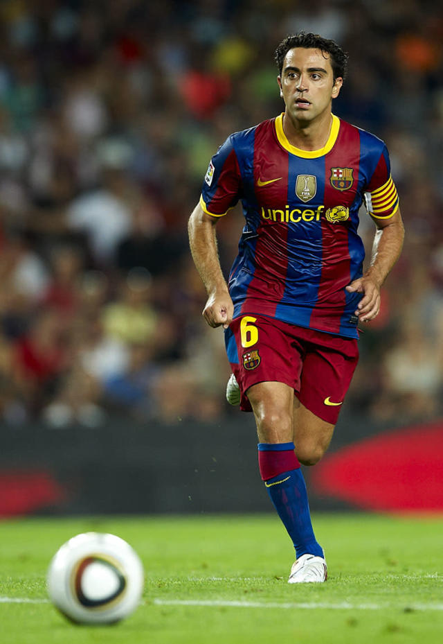 BARCELONA, SPAIN - AUGUST 21: Xavi Hernandez of FC Barcelona in action during the Spanish Supercopa, second leg, match between Barcelona and Sevilla at the Camp Nou stadium on August 21, 2010 in Barcelona, Spain. Barcelona won 4-0. (Photo by Manuel Queimadelos Alonso/Getty Images)