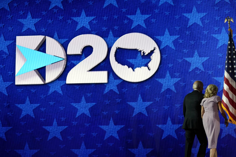 Democratic presidential candidate former Vice President Joe Biden and his wife Jill Biden walks from the stage during the fourth day of the Democratic National Convention, Thursday, Aug. 20, 2020, at the Chase Center in Wilmington, Del. (AP Photo/Andrew Harnik)