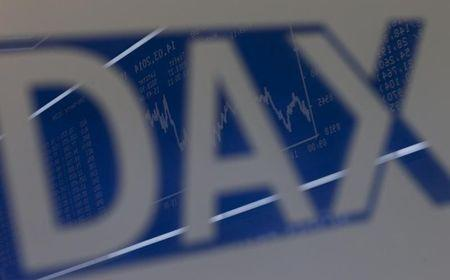 The DAX Index curve is mirrored in a DAX logo on the trading floor of Frankfurt stock exchange