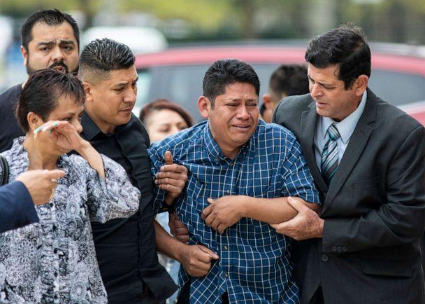 PHOTO: Arnulfo Ochoa, the father of Marlen Ochoa-Lopez, is surrounded by family members and supporters, as he walks into the Cook County medical examiner's office to identify his daughter's body, May 16, 2019, in Chicago. (Ashlee Rezin/Chicago Sun-Times via AP)