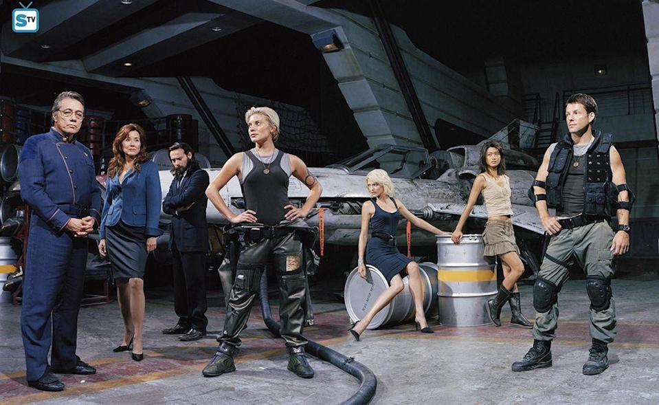 """<p>Even though the original <em>Battlestar Galactica</em>, which debuted in 1978, was deemed a <em>Star Wars</em> rip-off, the reboot, which ran from 2003-2009, collected a passionate cult following. In 2019, the sci-fi drama was even named one of the <a href=""""https://www.nytimes.com/interactive/2019/arts/television/best-drama-series.html"""" rel=""""nofollow noopener"""" target=""""_blank"""" data-ylk=""""slk:best dramas since The Sopranos"""" class=""""link rapid-noclick-resp"""">best dramas since <em>The Sopranos</em></a> by <em>The New York Times</em>. The series is set for a <a href=""""https://deadline.com/2020/07/battlestar-galactica-progressing-nicely-michael-lesslie-peacock-1202982542/"""" rel=""""nofollow noopener"""" target=""""_blank"""" data-ylk=""""slk:second revival"""" class=""""link rapid-noclick-resp"""">second revival</a> on the NBCU streamer, Peacock.</p>"""