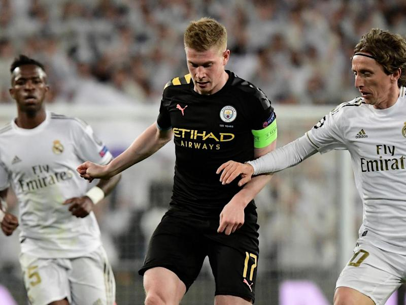 Manchester City midfielder Kevin De Bruyne vies with Real Madrid's midfielders: AFP via Getty Images