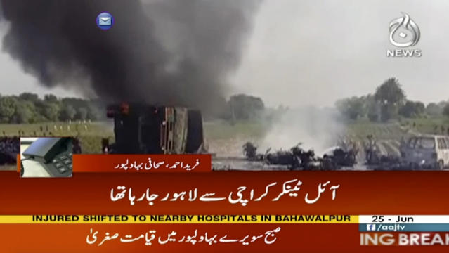 <p>In this image taken from video, black smoke rises from oil tanker on road in Bahawalpur, Pakistan, Sunday, June 25, 2017. An overturned oil tanker burst into flames in Pakistan on Sunday, killing people who had rushed to the scene of the highway accident to gather leaking fuel, an official said. (AAJ News via AP Video) </p>
